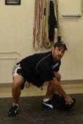 sandbag shoulder lunge - odd object lifting